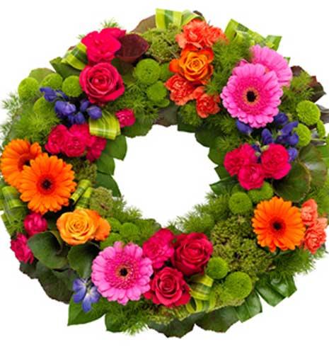 Farverig begravelseskrans fra Aarstidens Blomster