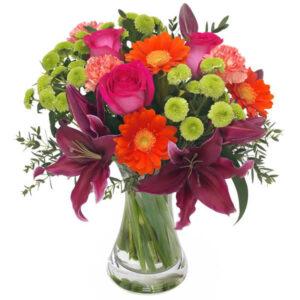 Buket i pangfarver fra Aarstidens Blomster